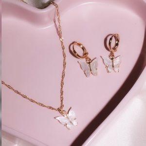White butterfly charm earrings